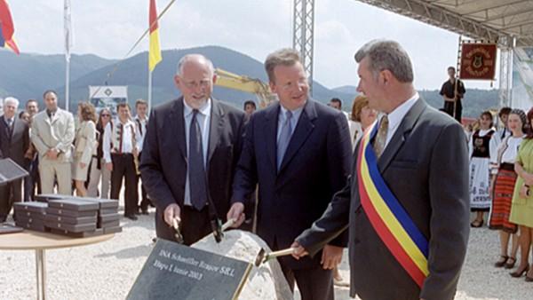 Aşezarea pietrei de temelie la Cristian pentru unitatea de producţie din România. Planul iniţial de construcţie este pentru trei hale.